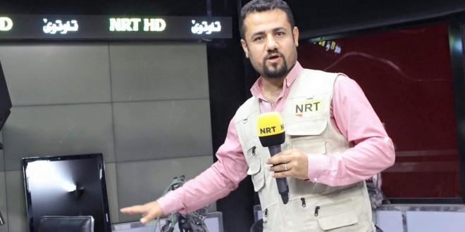 قوة أمنية تعتدي على مراسل NRT بالسلاح في السليمانية و ترحله لأرييل
